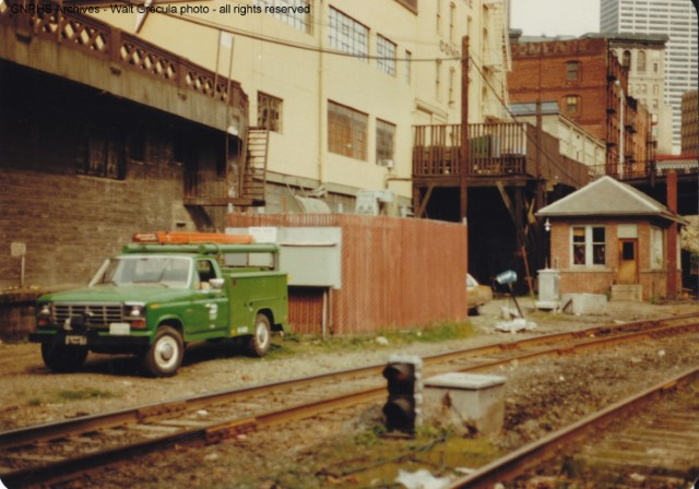 "BN-era photo of the GN interlocking ""tower"" outside the south portal of the downtown Seattle tunnel, just north of King St. Station, Seattle, WA.  Telegraph code ""UD"".  Photo by GNRHS member Walt Grecula."